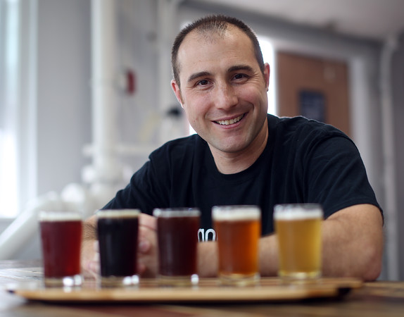 DAVID LE/Staff photo. Paul Gentile is the owner and founder of Gentile Brewing Company. He just opened a tap room on Park Street in Beverly. 7/8/16.
