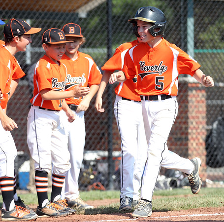 DAVID LE/Staff photo. Beverly's Griffin McCay smiles while approaching home plate after launching a homer against Fairhaven/Acushnet on Friday afternoon. 7/29/16.