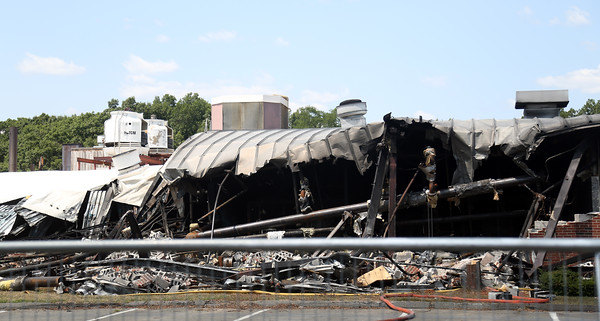 DAVID LE/Staff photo. Damage to foam factory on Fifth Street in Centennial Park in Peabody. 7/20/16.