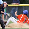 DAVID LE/Staff photo. Beverly's Dom Santos slides safely into third ahead of a tag from Masco third baseman Henry Sorenson. 7/8/16.