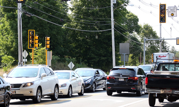 DAVID LE/Staff photo. New red and flashing yellow arrows at the intersection of Route 128 and Route 62 in Danvers has created even more traffic problems as a solution to the traffic issues is yet to be found. 7/20/16.