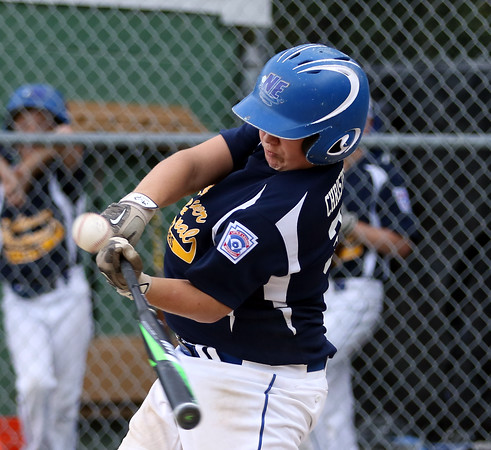 DAVID LE/Staff photo. Andover National catcher Owen Christopher lines a single to left against Beverly. 7/21/16.