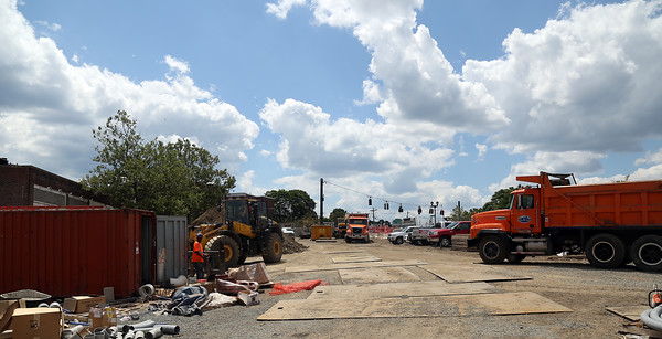DAVID LE/Staff photo. Ongoing construction in the parking lot along Washington Street at the corner of Dodge Street near the Starbucks in Downtown Salem. 7/19/16.