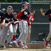 DAVID LE/Staff photo. The Masco little league team streams out of the dugout after Kevin Pelletier launched a walk-off two run homer against Gloucester. 7/2/16.
