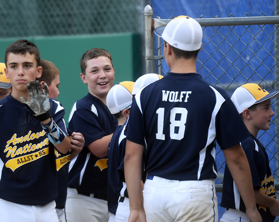 CARL RUSSO/Staff photo. Andover National Tyler Walles is congratulated by his teammates after hitting the first home run of the game for Andover. Andover defeated Woburn 16-6 in Little League action. 7/20/2016