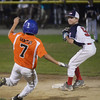 CARL RUSSO/Staff photo. Swampscott's Nate Marston gets Beverly's Dom Santos out at second base and looks to turn a double play in Little League action against Swampscott. 7/20/2016