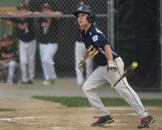 CARL RUSSO/Staff photo. Andover Nationals' Tyler Walles hits the first home run of the game for Andover. Andover defeated Woburn 16-6 in Little League action. 7/20/2016