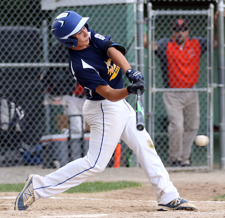 DAVID LE/Staff photo. Andover National three hitter Kyle Wolff lines a two RBI double against Beverly. 7/21/16.