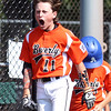DAVID LE/Staff photo. Beverly catcher Austin Bernard (11) screams in excitement following teammate's Griffin McCay's homer against Fairhaven/Acushnet. 7/29/16.