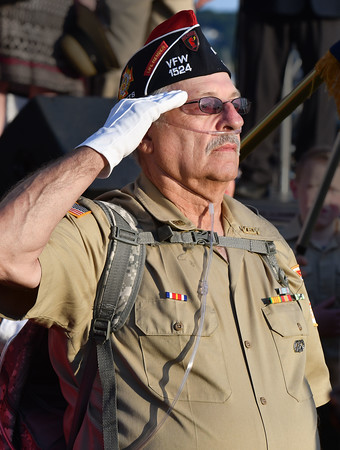 Offering a salute while the National Anthem is sung is Ray Leger.<br /> <br /> Photo by joebrownphotos.com
