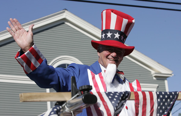 KEN YUSZKUS/Staff photo.  Paul Weingartener waves to the crowds at the Beverly Farms Horribles Parade.   07/04/16