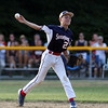 DAVID LE/Staff photo. Swampscott shortstop Mathew Schroeder fires across the diamond to cut down a Peabody West runner by a half step. 7/15/16.