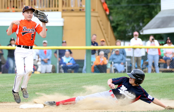 DAVID LE/Staff photo. Beverly second baseman Griffin McCoy leaps off the base after recording the force out on Masco's Nick Cantalupo as he slides into the base. 7/8/16.