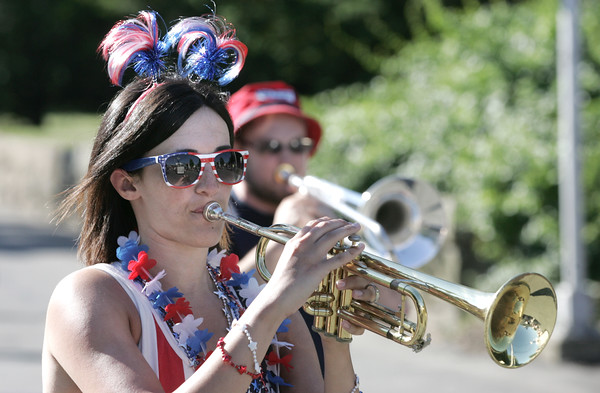 KEN YUSZKUS/Staff photo.  Trish Gately of the Tony Barrie Band plays the trumpet in the Beverly Farms Horribles Parade.   07/04/16
