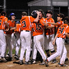 TIM JEAN/Staff photo<br /> Beverly's Joey Loreti is swarmed by his teammates after hitting a home run againt Andover during the Section 4 Little League all-star championship game.  7/23/16