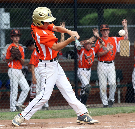 DAVID LE/Staff photo. Beverly's Joe Kotwicki lines another hit against Pittsfield American. 7/28/16.
