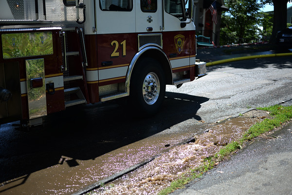 PAUL BILODEAU/Staff photo. A water main on Bay View Drive ruptured near a fast moving, multi-alarm fire on Bay View Drive in Swampscott.