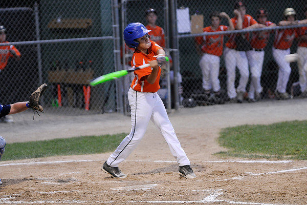 TIM JEAN/Staff photo<br /> Beverly's Dom Santos drives the ball for a hit against Andover during the Section 4 Little League all-star championship game.   7/23/16