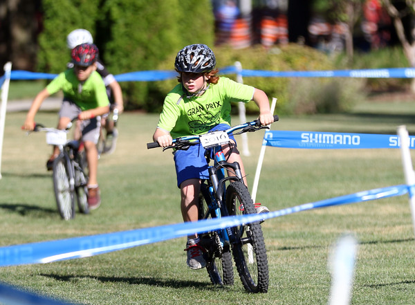 DAVID LE/Staff photo. Kids participating in the annual kids races at the Beverly Gran Prix race around Beverly Common prior to the start of the Elite Men's and Women's Races on Wednesday. 7/29/16.