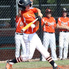 DAVID LE/Staff photo. Beverly's Griffin Francis leads off the game with a base hit against Fairhaven/Acushnet. 7/29/16.