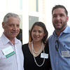 DAVID LE/Staff photo. Jeff Starfield, of Northeast Business Partner, left, with Herzen Martin and Jason Hyland, of Net Atlantic Inc,  at an after hours networking event held at the Salem Country Club in Peabody by the North Shore Chamber of Commerce. 7/20/16.