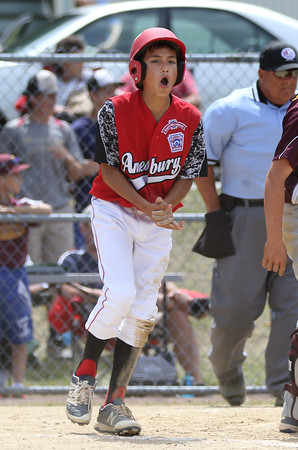 DAVID LE/Staff photo. Amesbury's Jeremy Lopez lets out a whoop of excitement after crossing the plate with their first run of the afternoon. 7/2/16.