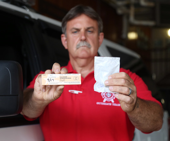 DAVID LE/Staff photo. Peabody Fire Captain Ted Quinn, displays a sample of Narcan that the Peabody Fire Department are distributing to people who are at risk of opioid overdose. 7/19/16.
