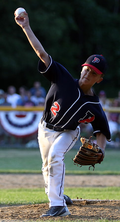 DAVID LE/Staff photo. Peabody West reliever Zach Fisher fires a pitch against Swampscott. 7/15/16.