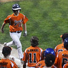 CARL RUSSO/Staff photo. Beverly's pitcher, Joey Loreti is greeted by his teammates after hitting a home run in Little League action against Swampscott. 7/20/2016