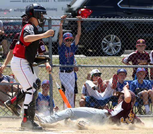 DAVID LE/Staff photo. Danvers National's Dylan Wodarski slides safely home after stealing home on Amesbury on Saturday afternoon. 7/2/16.
