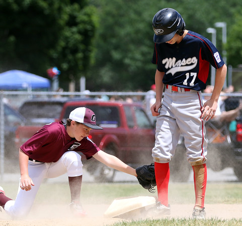 DAVID LE/Staff photo. Masco's Nick Cantelupo stands safely on second base ahead of the tag from Gloucester's Carson Harwood. 7/2/16.