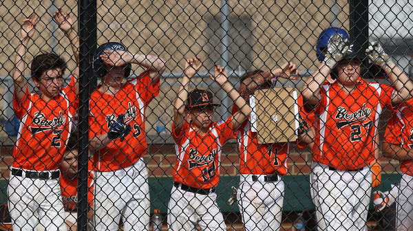 DAVID LE/Staff photo. Beverly players out towards the diamond while down three runs in the top of the 6th inning to Pittsfield American. 7/28/16.