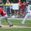 KEN YUSZKUS/Staff photo.   Manchester Essex's James McKenna can't make it to 1st base as Boxford-Topsfield's Kevin Pelletier got the throw during the Boxford-Topsfield vs. Manchester Essex Little League playoff game at Harry Ball Field in Beverly.    07/11/16