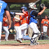 DAVID LE/Staff photo. Beverly's Charlie Mack slides around the Fairhaven/Acushnet catcher to score one of Beverly's 19 runs on the afternoon. 7/29/16.