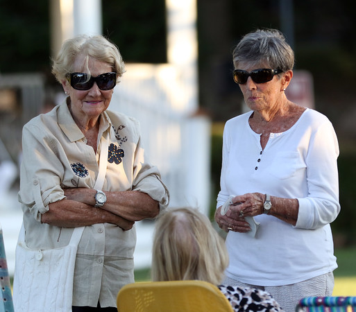 DAVID LE/Staff photo. Ginny Brophy, left, and Maureen Griffin, right, talk with Natalie MacLeod, during an intermission from the summer jazz concert at Beverly Common on Thursday evening. 7/21/16.