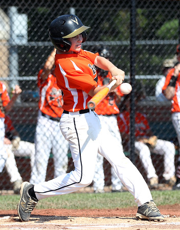 DAVID LE/Staff photo. Beverly's Griffin McCay launches a homer against Fairhaven/Acushnet. 7/29/16.