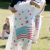 KEN YUSZKUS/Staff photo.  Timothy Truong, 5, won the under 6 sack race at the Peabody July 4 activities held at the O'Connor Park at the Welch School.   07/04/16
