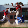 DAVID LE/Staff photo. Newburyport second baseman Quin Stott tries to avoid landing on sliding Middleton-Peabody runner Nick Colucci (15) as Newburyport shortstop Kiernan Haley tracks down the overthrow. 7/19/16.