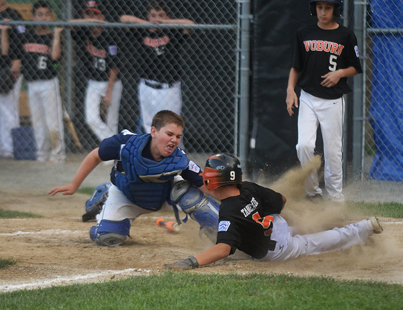 CARL RUSSO/Staff photo. Andover Nationals' catch, Owen Christopher puts the tag for the out on Woburn's Jonathan Surrette. Andover defeated Woburn 16-6 in Little League action. 7/20/2016
