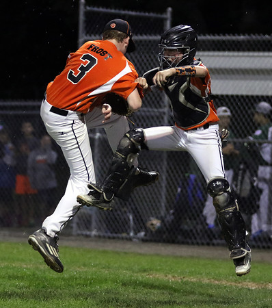 DAVID LE/Staff photo. Beverly closer Brennan Frost and catcher Austin Bernard leap in the air in celebration after Frost retired the last batter of the game to earn a save in a 4-2 over Manchester-Essex in the District 15 Championship. 7/14/16.