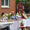 DAVID LE/Staff photo. Local vendors set up tables along the sidewalk on Hale Street in Beverly Farms on Friday for a sidewalk bazaar. 7/8/16.