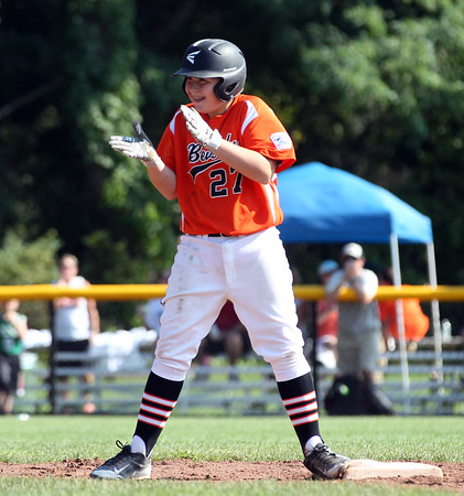 DAVID LE/Staff photo. Beverly's Nick Fox claps his hands while standing on second after lining an RBI double. 7/29/16.