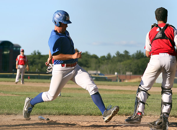 DAVID LE/Staff photo. Middleton-Peabody's Spencer Balian crosses the plate as he scores the game's first run on a fielder's choice against Newburyport. 7/19/16.