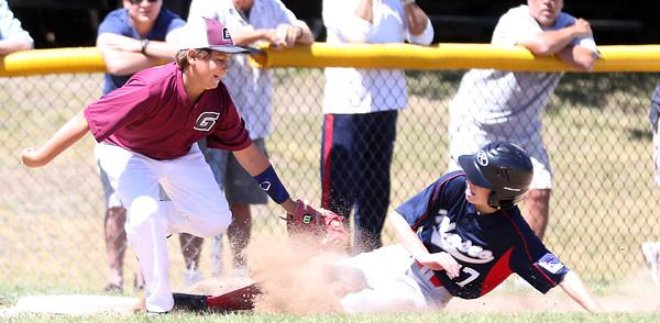 DAVID LE/Staff photo. Masco's Nick Cantelupo manages to slide just under the sweeping tag from Gloucester third baseman Zach Morris on a close play at third. 7/2/16.