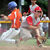 DAVID LE/Staff photo. Beverly's Joe Brown, left, slides safely into second base on an overthrow on a double play attempt before Pittsfield American shortstop Brendan Stannard can receive the relayed throw. 7/28/16.