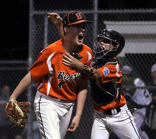DAVID LE/Staff photo. Beverly catcher Austin Bernard leaps on the back of closer Brennan Frost in celebration after Frost retired the last batter of the game to earn a save in a 4-2 over Manchester-Essex in the District 15 Championship. 7/14/16.