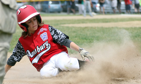 DAVID LE/Staff photo. Amesbury's Shea Cucinutta slides safely into third after advancing on a wild pitch. 7/2/16.