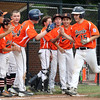 DAVID LE/Staff photo. Beverly's Joey Loreti (15) gets greeted at home plate by his teammates following a moon-shot homer against Pittsfield American. 7/28/16.