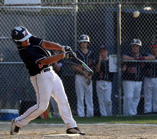 DAVID LE/Staff photo. Peabody West starting pitcher Dom Annese launches a 2-run homer against Swampscott.7/15/16.