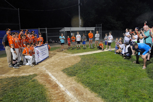 TIM JEAN/Staff photo<br /> Beverly's players and coaches pose for photographs with the winning banner after defeating Andover 9-4 during the Section 4 Little League all-star championship game.  7/23/16